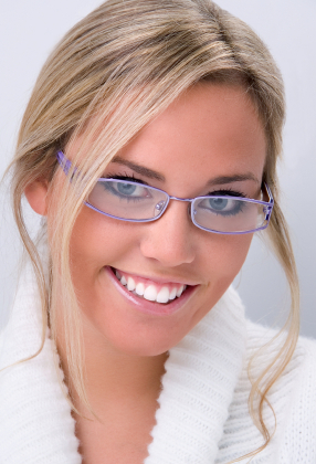 Women with white teeth after receiving teeth whitening